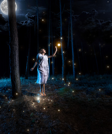 firefly: Lost young woman at night forest with full moon jumping high to reach firefly