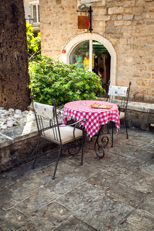 Beautiful view of two chairs and table on summer terrace of old restaurant 스톡 콘텐츠