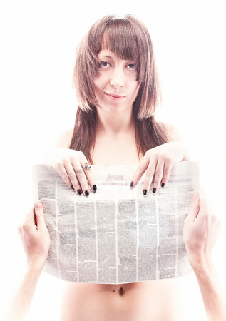 Closeup portrait of men hands closing naked woman with newspaper photo