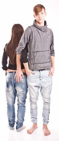 Isolated shot o handsome man holding hand in back pocket of girlfriends jeans photo
