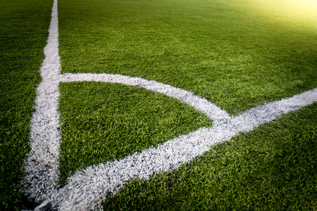 sideline: Photo of corner of soccer field lit by sun rays Stock Photo