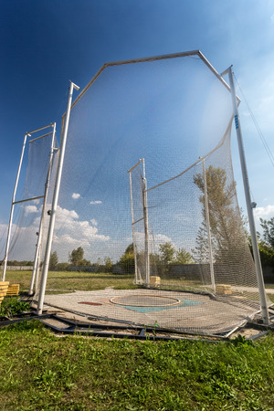 Arena for throwing hammer surrounded by high safety net photo