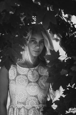 sexy middle aged woman: Closeup monochrome portrait of sexy middle aged woman standing under tree