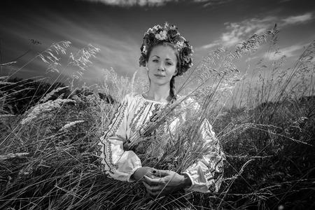 Monochrome portrait of national ukrainian woman in wheat field photo