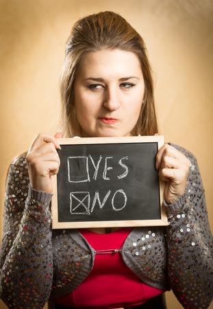 Closeup portrait of woman choosing negative answer box photo