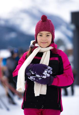 Closeup portrait of cute smiling woman posing against high Alps photo