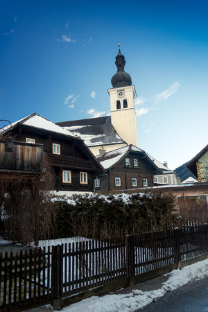 austrian village: Landscape of old catholic church at Austrian village covered by snow