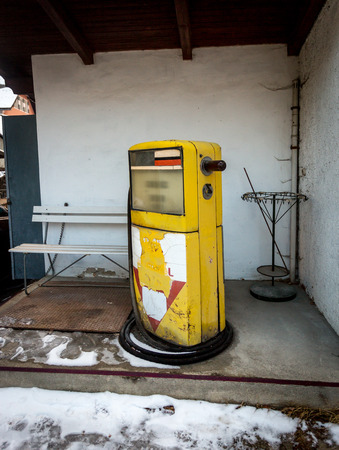 abandoned gas station: Old abandoned gas station with yellow pump Stock Photo