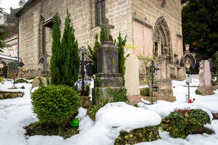 churchyard: Big cemetery covered by snow at old churchyard
