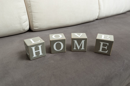 home concept: Conceptual photo of word home and love written on toy bricks