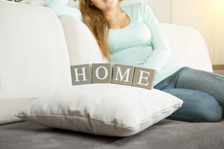 Conceptual photo of word Home spelled by letters on blocks photo