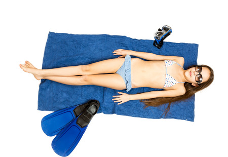 girl with towel: Isolated photo of cute girl in sunglasses lying on towel and having sunbath