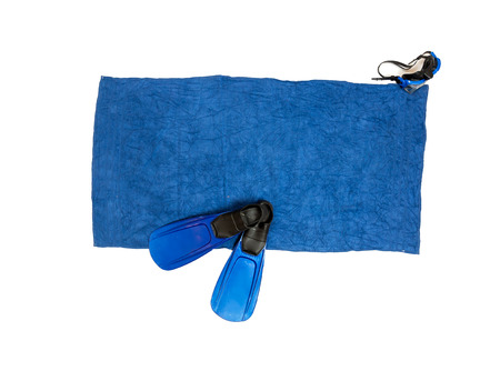 in towel: Isolated photo of flippers and snorkeling mask lying on blue beach towel Stock Photo