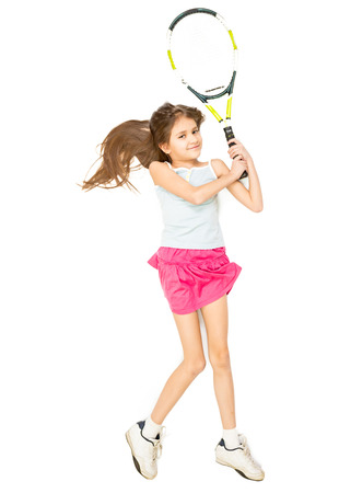 beat the competition: View from high point of girl lying on floor and pretending to play tennis