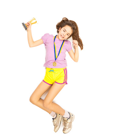 point of view: Isolated photo from high point view of happy girl jumping with trophy cup and gold medal