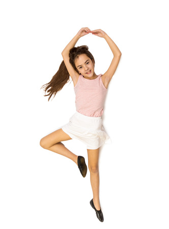 Isolated photo from high point view of cute girl lying on floor and pretending to dance ballet Banco de Imagens