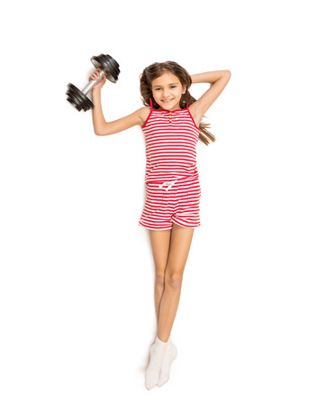 point of view: Isolated photo from high point view of cute girl doing exercise with dumbbell Stock Photo