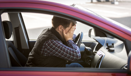 sad businessman: Closeup portrait of shocked male driver closing face with hands