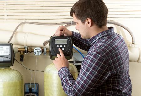 Portrait of engineer checking pressure meters at factory Foto de archivo