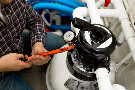 Closeup shot of handyman installing manometer on high pressure system 免版税图像