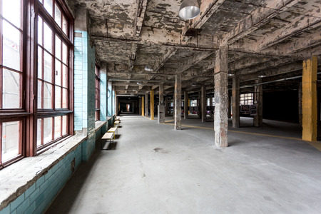 empty warehouse: Old abandoned industrial interior with hall and big windows Stock Photo