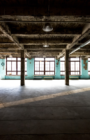 abandoned warehouse: Old abandoned warehouse at factory with long hallway and big windows Stock Photo