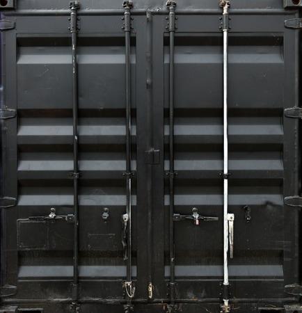 black metal: Black metal door of freight container Stock Photo