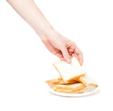 pan frances: disparo aislado de la pieza de mano de viradas masculina de pan para tostadas