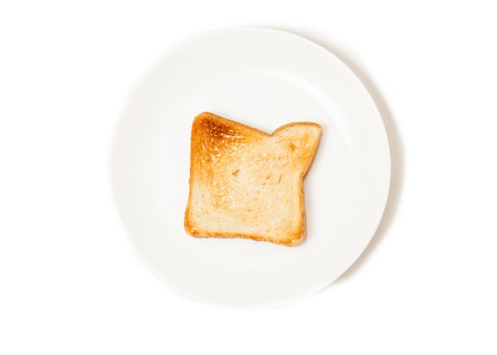 Closeup isolated shot of fresh baked toast on white dish photo