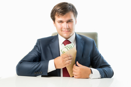 venal: Isolated portrait of venal politician putting money in envelope in pocket of his suit