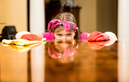 table surface: Closeup portrait of girl cleaning house checking table surface