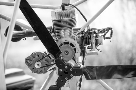 engine powered: Closeup black and white photo of paraglider engine and propeller