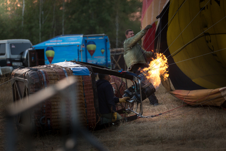 adventure aeronautical: Process of filling balloon with hot air from gas burner Stock Photo