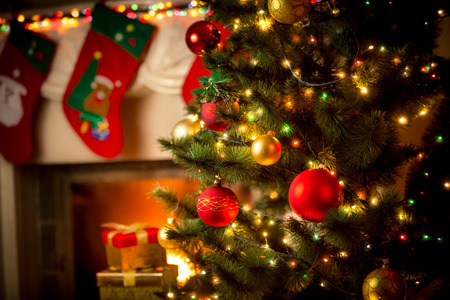 Beautiful decorated fireplace and Christmas tree at cottage Archivio Fotografico