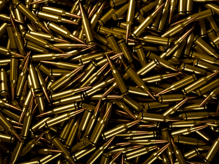 Closeup background of pile of polished rifle bullets Фото со стока