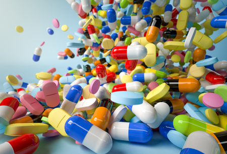 Many colorful pills and capsules falling on white background. 3d render