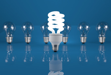metal filament: Conceptual image of energy saving. Eco light bulb in row of incandescent bulbs. Stock Photo