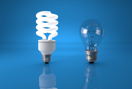 comparing: Concept of technology evolution. Eco energy saving bulb comparing to old incandescent bulb.