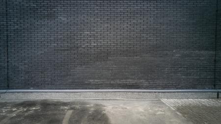 outdoor shot: Outdoor shot of black brick wall and concrete floor