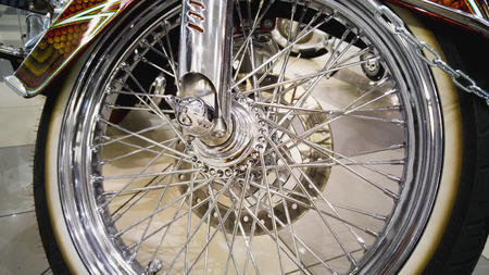chromed: Closeup photo of chopper motorcycle chromed front wheel