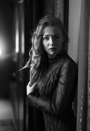 hotel hallway: Closeup portrait of woman in vintage dress posing at hotel hallway Stock Photo