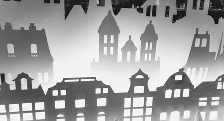 old buildings: Backlit silhouettes of old buildings made of paper