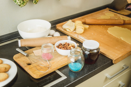 messy kitchen: Messy kitchen with ingredients for baking lying on working table Stock Photo