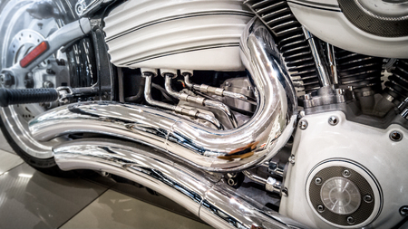 exhaust system: Closeup toned photo of chromed motorcycle exhaust system and engine