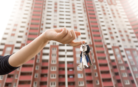 Closeup photo of woman holding keys from new apartment