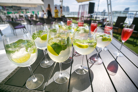 Closeup image of mojito cocktails on the banquet table at outdoor summer terrace Фото со стока