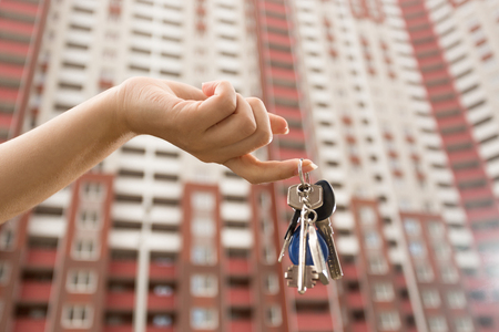 realestate: Female hand holding keys from new apartment