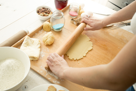 easter cookie: Woman making dough for cookies
