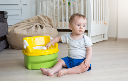 10 months old baby boy getting accustomed to using chamber pot