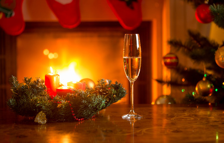 Glass with champagne on Christmas table